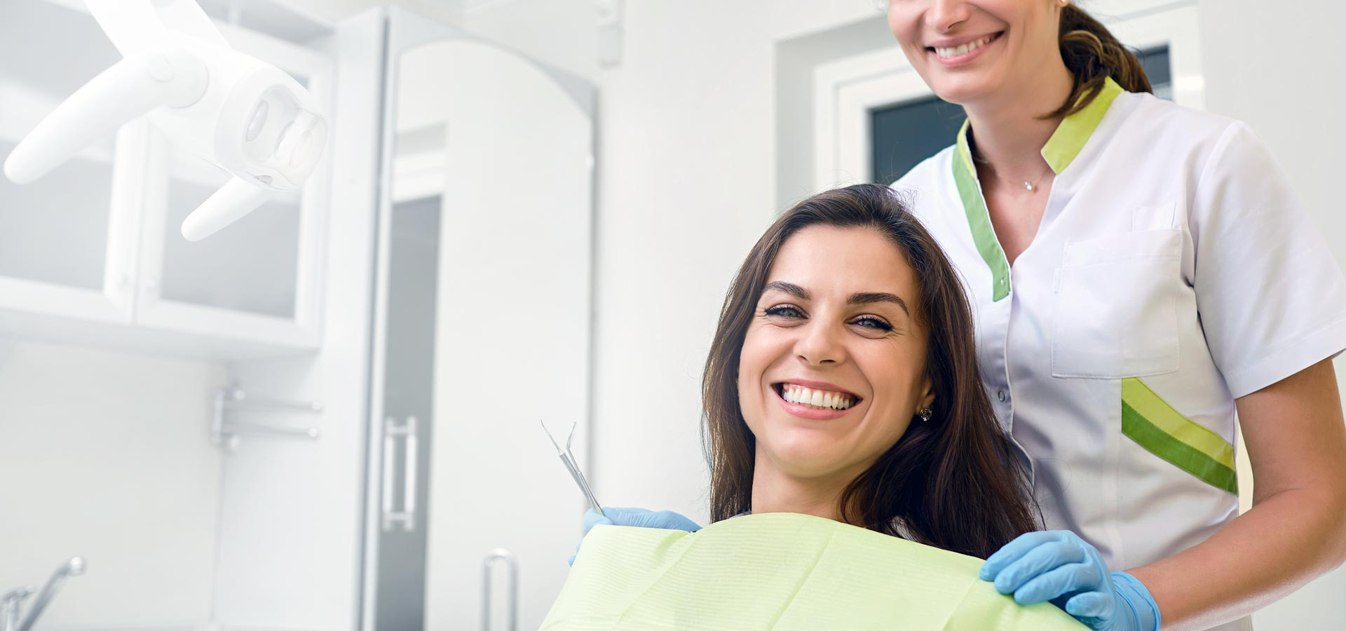woman and dental hygienist smiling